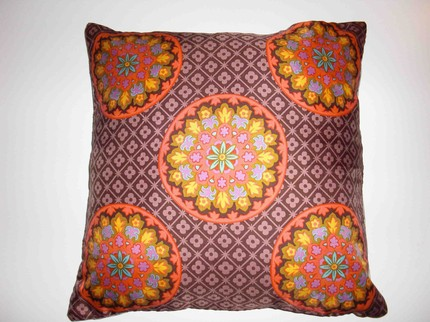 Buy a scarf pillow, like this Mod Floral Medallion Scarf Pillow ($25), or create one out of two vintage scarves.