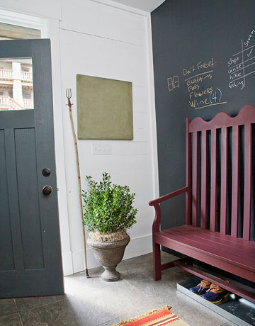 Move an urn off the front walk and into an entry. I like the unexpected look of this outdoor planter indoors.  Source