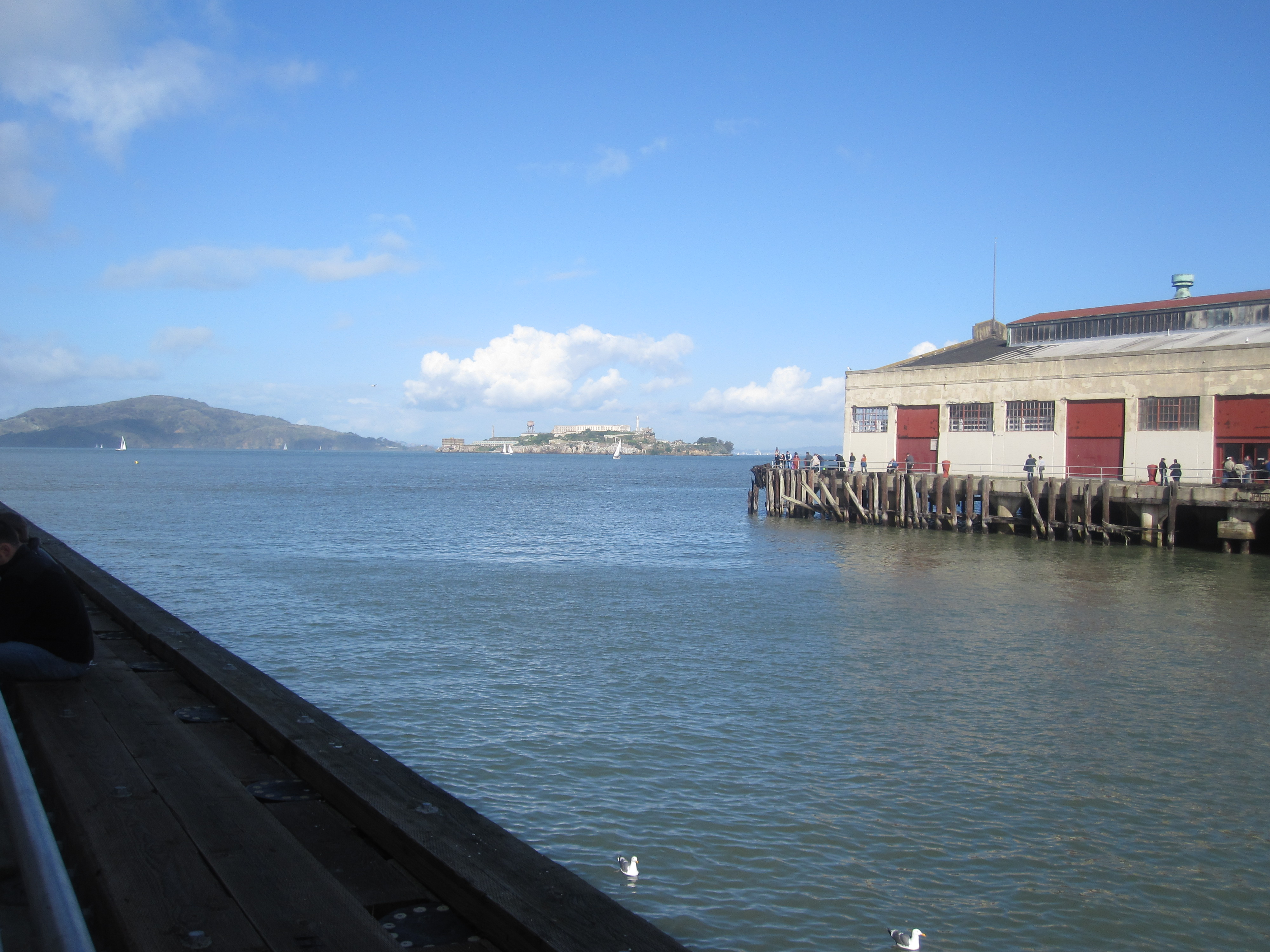 The event is held at Fort Mason on the San Francisco Bay. The view is of Alcatraz.