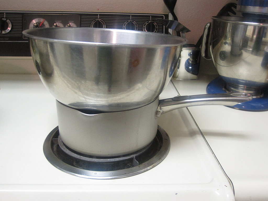 Prepare a double boiler. Fill a saucepan with water and bring to a boil over high heat. Set the heatproof bowl with the chopped chocolate on top of the saucepan. Be sure the bowl does not directly touch the water.