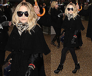 Mary-Kate Olsen at London Fashion Week Wearing Black Cape Coat and Blue Proenza Schouler Clutch