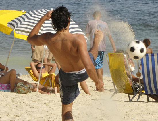 Guess Who's Playing Soccer Shirtless on the Beach?