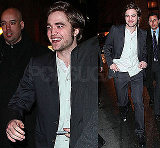 Photos of Robert Pattinson Signing Autographs for Fans Outside NYC Remember Me Premiere