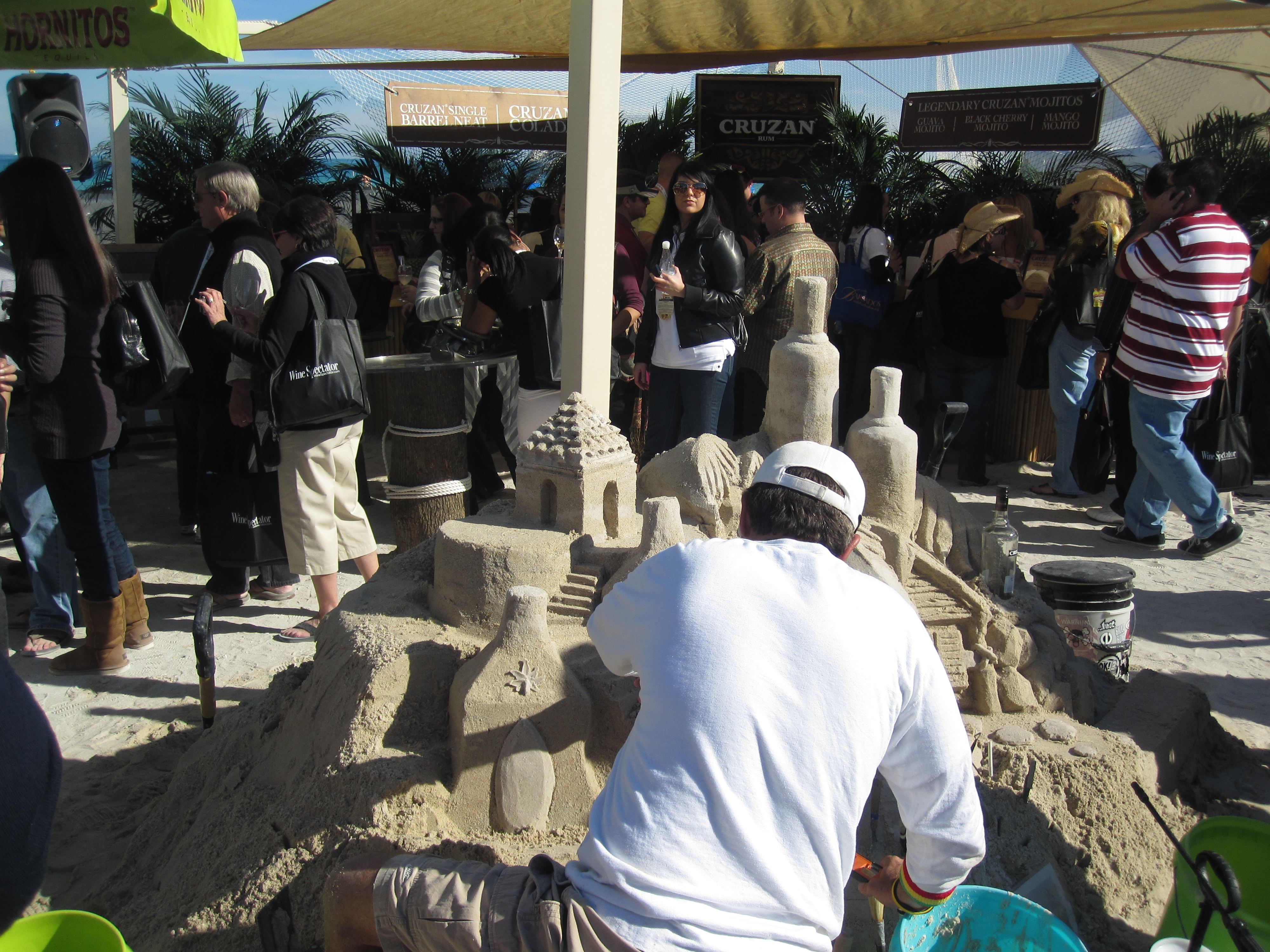 A sand castle is being made in the middle of the two tasting tents, how fun is that?