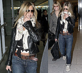 Photos of Jennifer Aniston Wearing a Black Leather Jacket and Scarf Arriving at Heathrow Airport in London