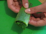 Wrap the outer leek section tightly, creating a neat herb packet.