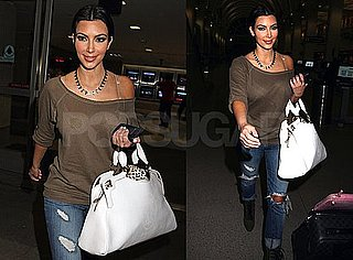Photos of Kim Kardashian Arriving at LAX Airport Wearing Cute Jeans
