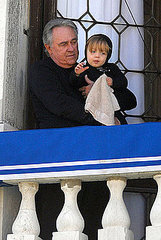Brad Pitt's father checks out the view from his son's balcony while holding onto little Knox