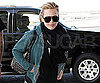 Slide Picture of Hilary Duff Wearing a Hoodie and Scarf at JFK