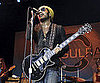 Slide Picture of Lenny Kravitz Performing at New Orleans Benefit Concert