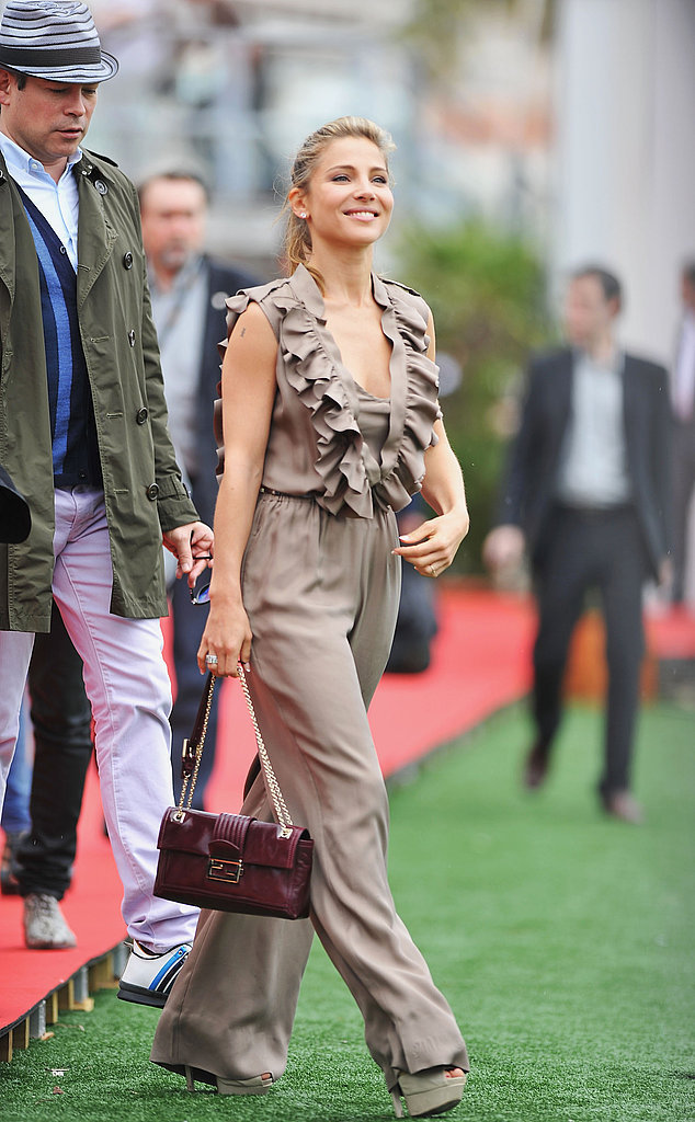 Elsa Patakay wore a ruffled jumpsuit and burgundy Fendi bag to the festivities.