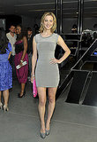 Eva Amurri in a body-con gray dress and matching heels. Love the pink clutch.