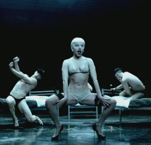 Gaga does a dance number in nude underthings and thigh-high stockings. Dirty sexy. And that bed dancing — yowza!