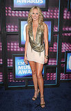 Laura Bell Bundy in gold chain mail and nude.