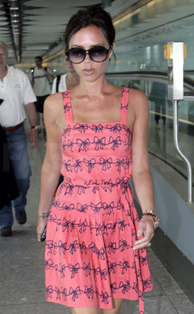 Photos of Victoria Beckham Wearing Marc by Marc Jacobs Bow Print Dress