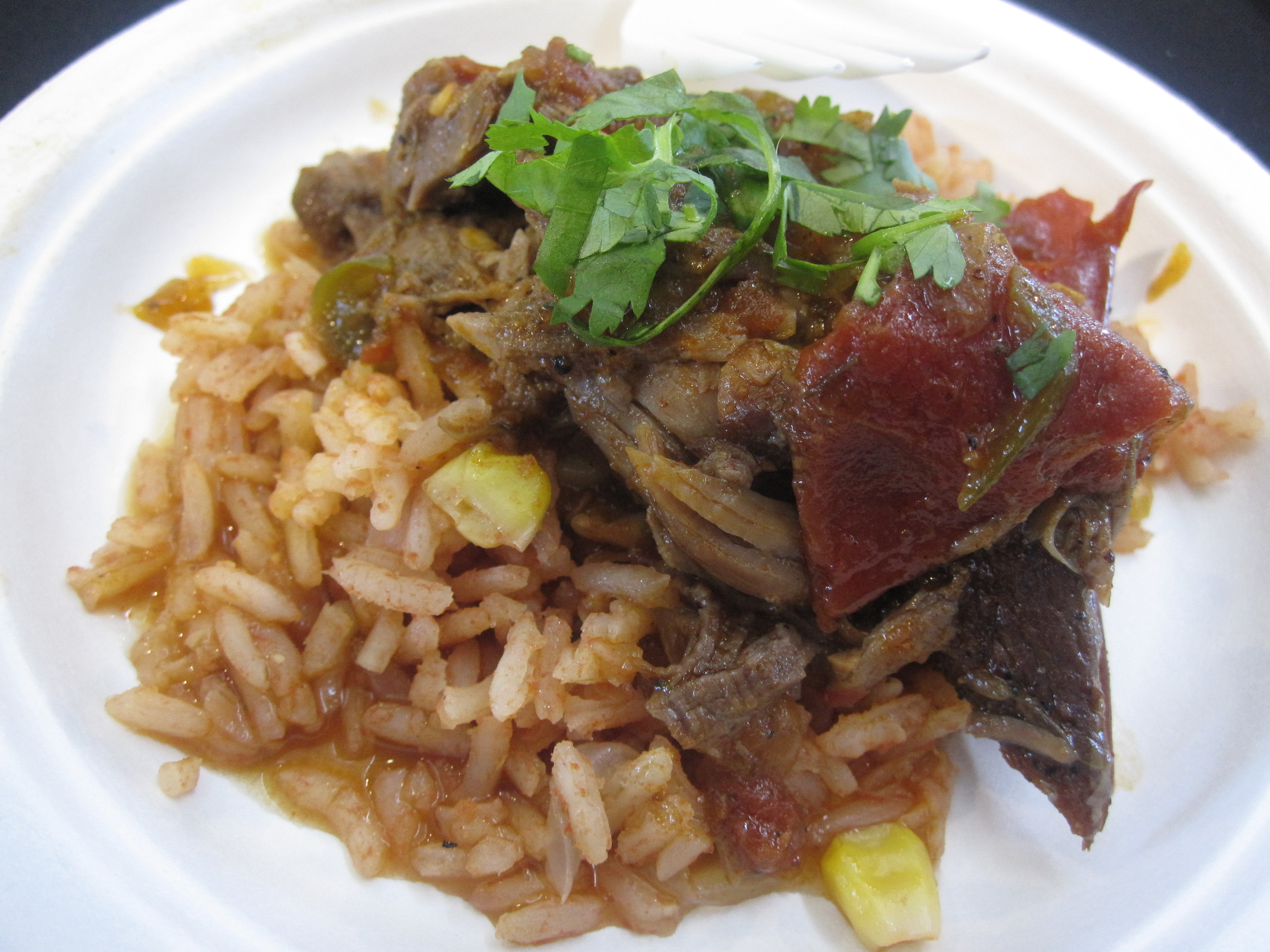 An incredibly spicy lamb shank served on Mexican rice was next. It would have been scrumptious with a soft taco and icy beer.