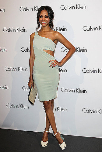 Zoe in a sage-green cutout dress by Calvin Klein — get a similar look.