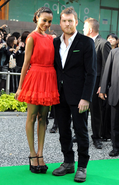 Zoe looks super cute in a tomato-red flippy dress by Giambattista Valli at the 22nd Tokyo International Film Festival Opening Ceremony in '09 — get a similar look.
