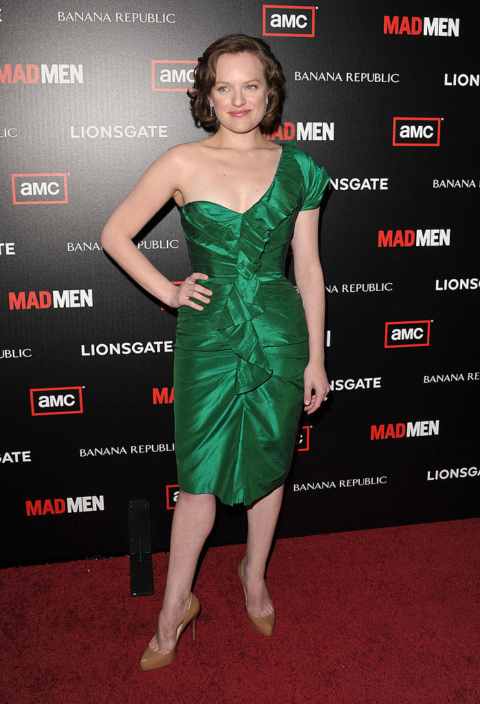 Mad Men's Elisabeth Moss is retro-tastic in this emerald washed taffeta one-shoulder Oscar de la Renta dress. Excellent color on her.
