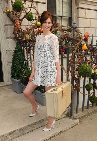 English singer and model Sophie Ellis-Bextor opted for an airy lace LWD with a black tank dress underneath.