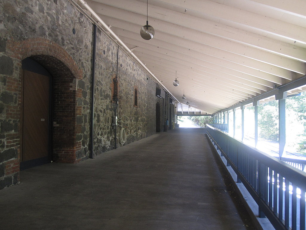 In order to build the train tracks, the railroad company had to blow up a hill. The leftover rocks and debris were used to make this building. When the winery hosts weddings, the cocktail reception is often held in the long corridor.