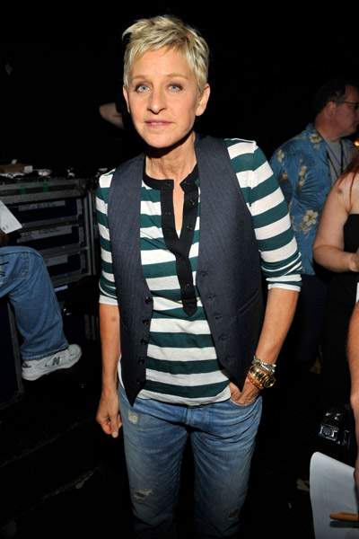 Ellen, cool in stripes, jeans, and a menswear-inspired vest.