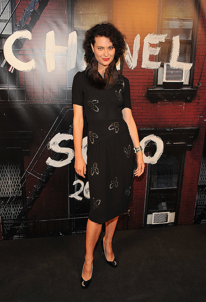 Shalom Harlow's look is a little retro throwback: black sheath, red lips, peep-toe pumps.