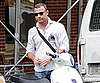 Slide Picture of Liev Schreiber Cranking Up His Vespa in NYC