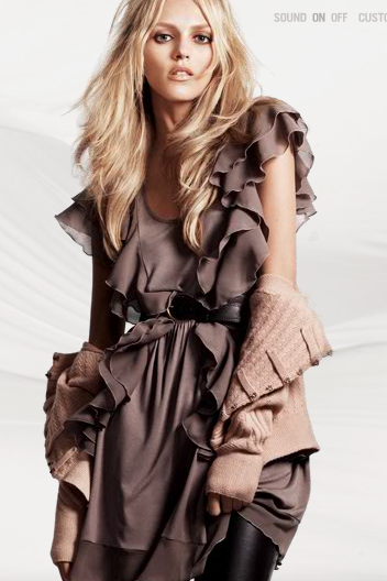 The ruffles are girlie, but the dark color of the dress tempers the femme factor.