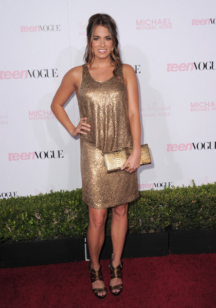 Nikki Reed opted for a Michael Kors gold paillette dress from the Fall 2010 collection, Michael Kors gold leather platform sandals, and a Michael Kors dark gold python clutch.