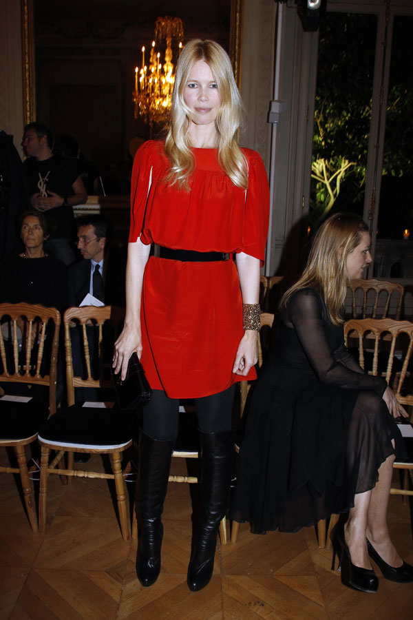 Claudia Schiffer takes the front row at YSL in black and red.