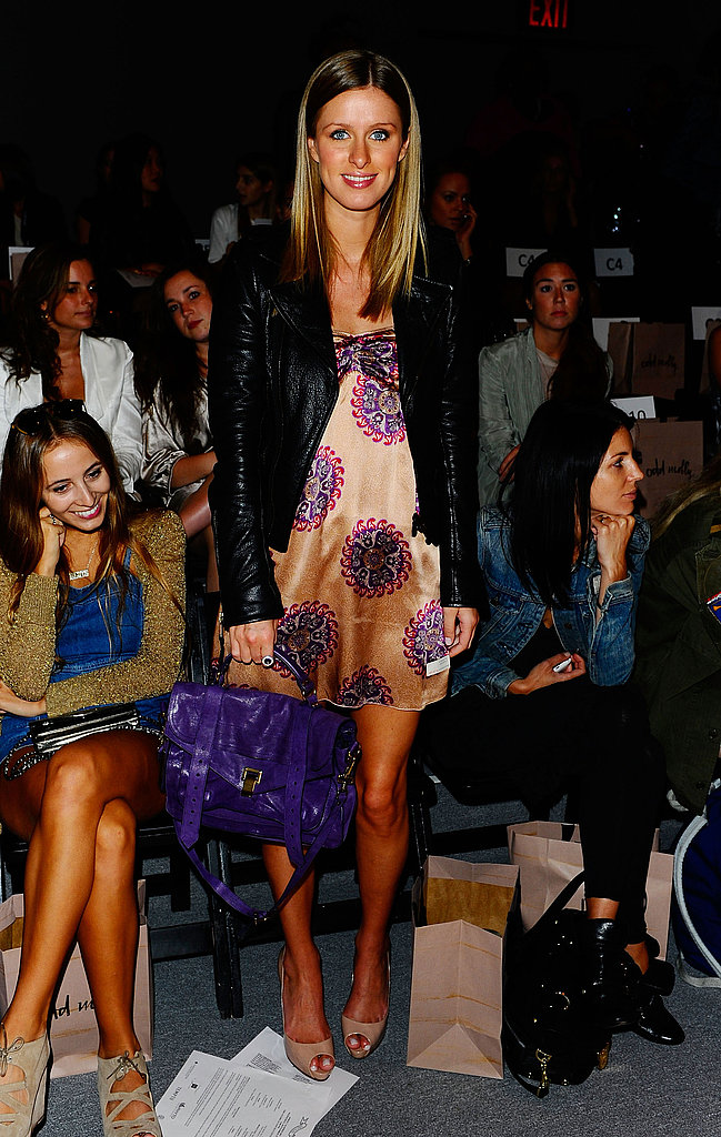 Purple pop — Nicky's pretty mini and bright purple Proenza Schouler bag are a pretty contrast to rocker-chic leather.