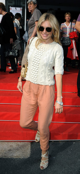 I adore the colors in Sienna Miller's outfit here — a pair of silky peach pants and a knit top are a good match.