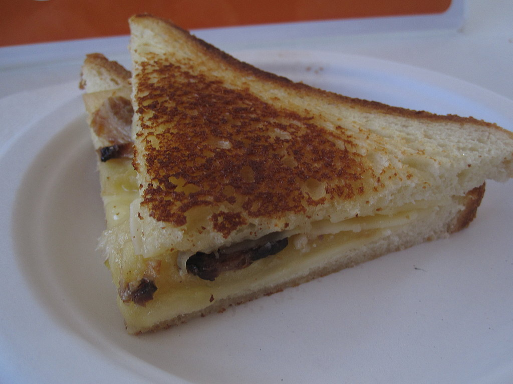 Bacon, thinly sliced apple, and melted white cheddar make one scrumptious grilled cheese sandwich.