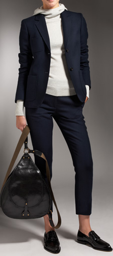 The ultimate in city-girl cool: a fitted blazer layered over a cashmere hoodie. Don't forget your rucksac!