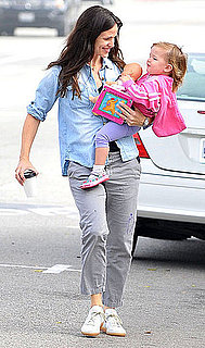 Pictures of Violet and Seraphina Carrying a Doll and a Book in LA