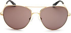Every gal needs a classic aviator a la this The Row Aviator pair ($325).