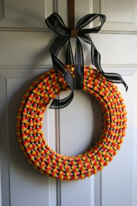 I love the pattern created by rows of candy corn on this wreath. A wreath form, candy corn, hot glue gun, ribbon, and a lot of patience are all that's required. Source