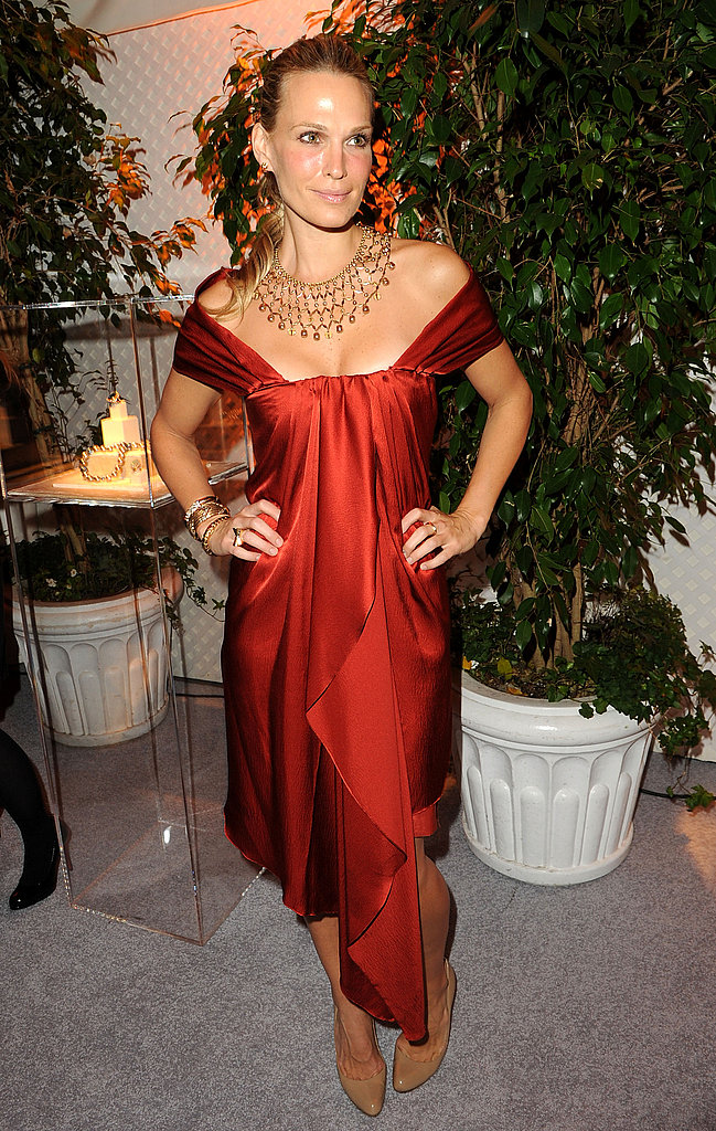 Molly Sims is statuesque and beyond gorgeous in Elise Overland and statement jewels.