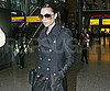 Slide Picture of Victoria Beckham at Heathrow