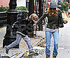Slide Picture of Sarah Jessica Parker and James Wilkie Jumping Puddles in NYC