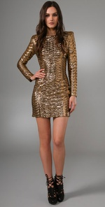 """""""I love everything about this dress. I would pair it with black tights, heels, and a major cocktail ring."""" Torn by Ronny Kobo Bella Pleated Metallic Dress ($385)"""