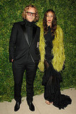Pucci's Peter Dundas arrives in all black; Joan Smalls chose texture via a feathered throw.