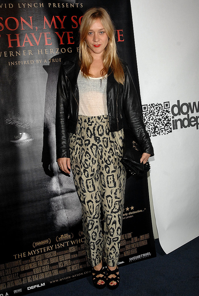 Totally fierce in leather and cat print at a film premiere in Dec. '09.