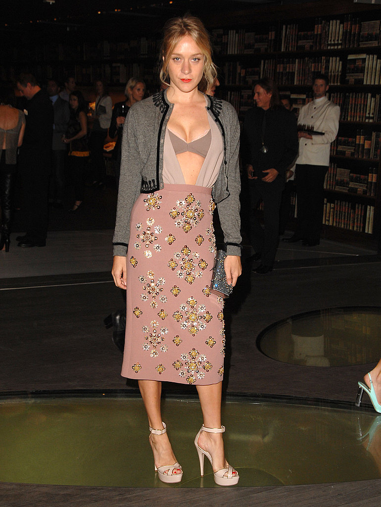 Exposing a little decolletage at Prada's book party in Nov. '09.
