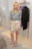 Dree Hemingway's delicate, floral skirt is offset by a slouchy, gray sweater.