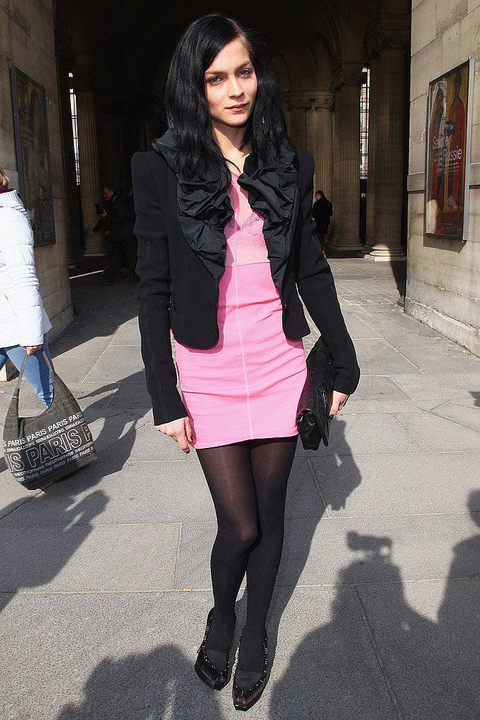 Leigh Lezark in a Louis Vuitton blazer and hot pink mini during Paris Fashion Week.