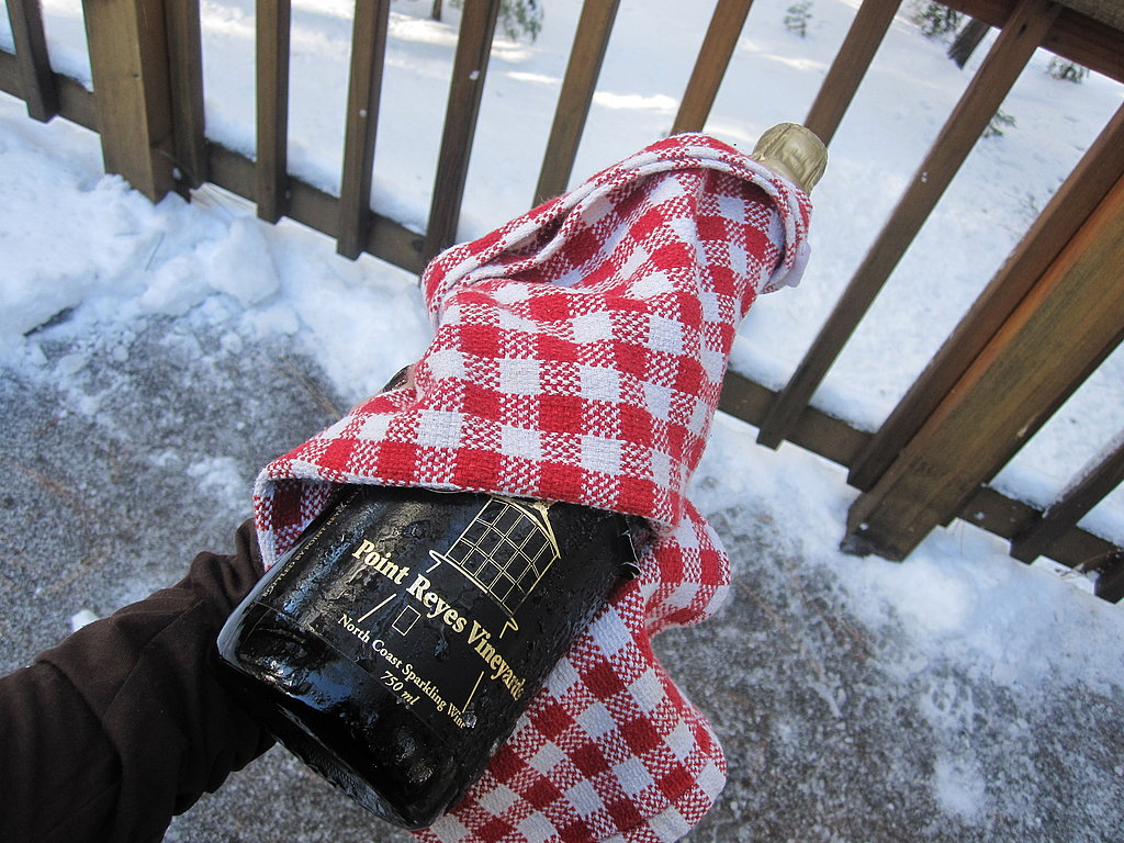 When you are ready to drink the champagne, wrap the bottle in a kitchen towel.