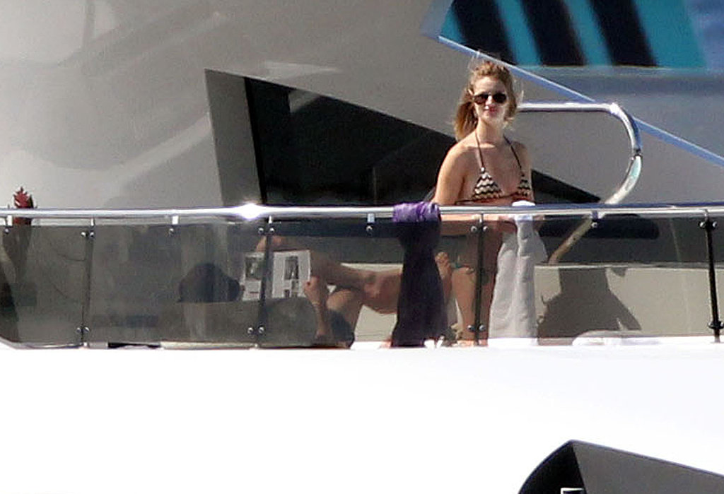 Bikini-Clad Rosie Huntington-Whiteley Welcomes 2011 Making Out With Jason Statham!