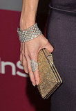 Julie Benz combines a chic bracelet, ring, and gold clutch. Perfection.